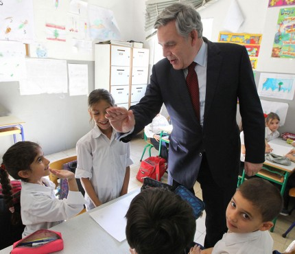 Gordon Brown visits Syrian refugee children in Lebanon in a school supported by United Nations programs.